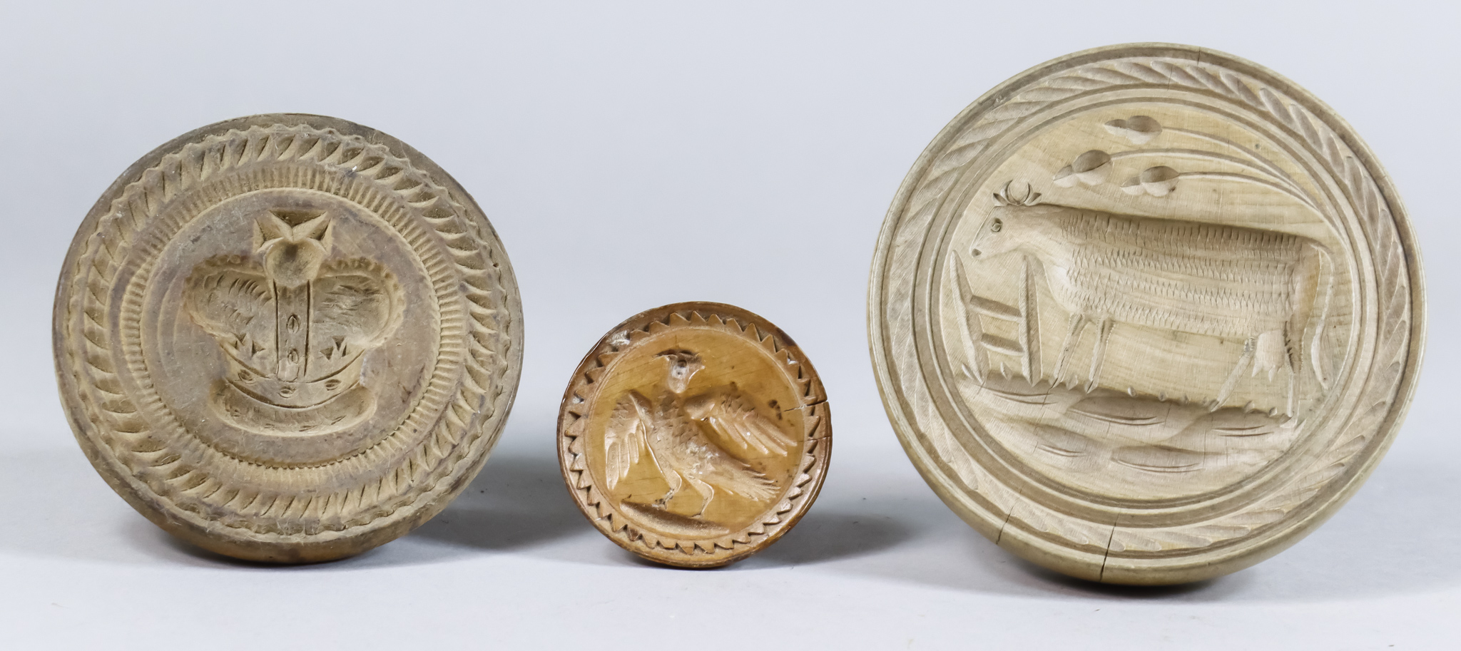 Three Carved Wood Butter Stamps, Victorian, carved with a Royal crown, 4ins diameter, a bird, 2.