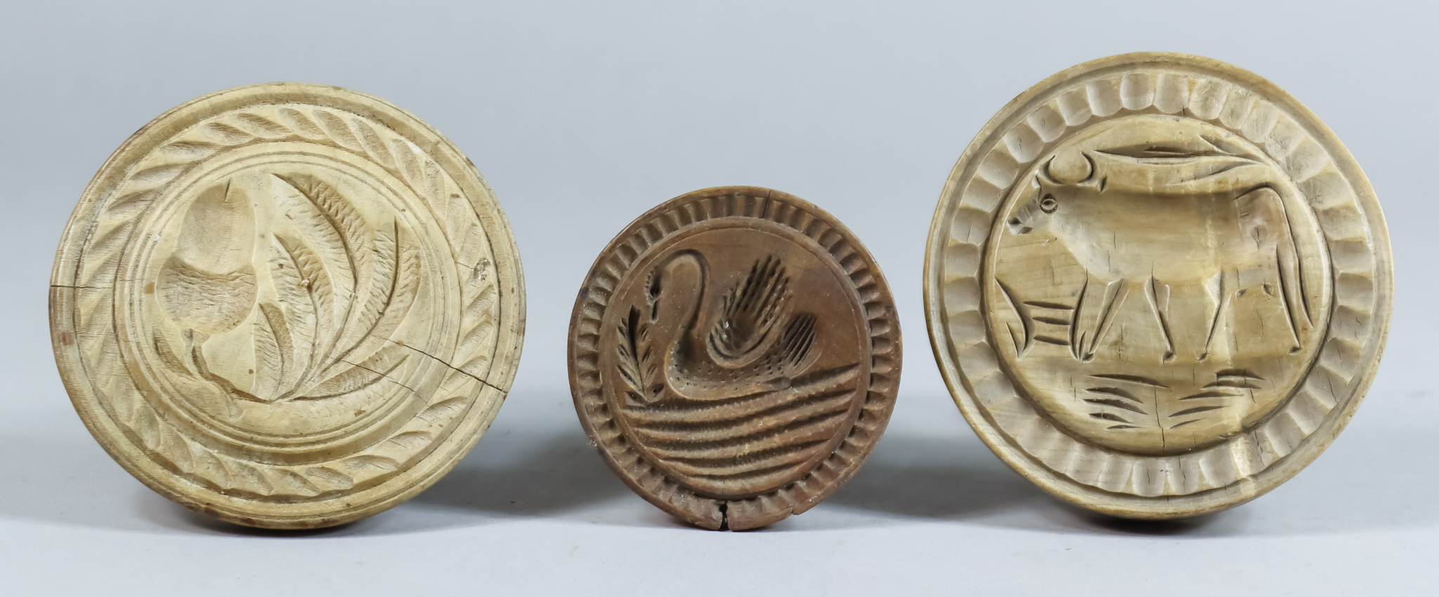 Three Carved Wood Butter Stamps, Victorian, carved with an acorn and leaves, 3.75ins diameter, a