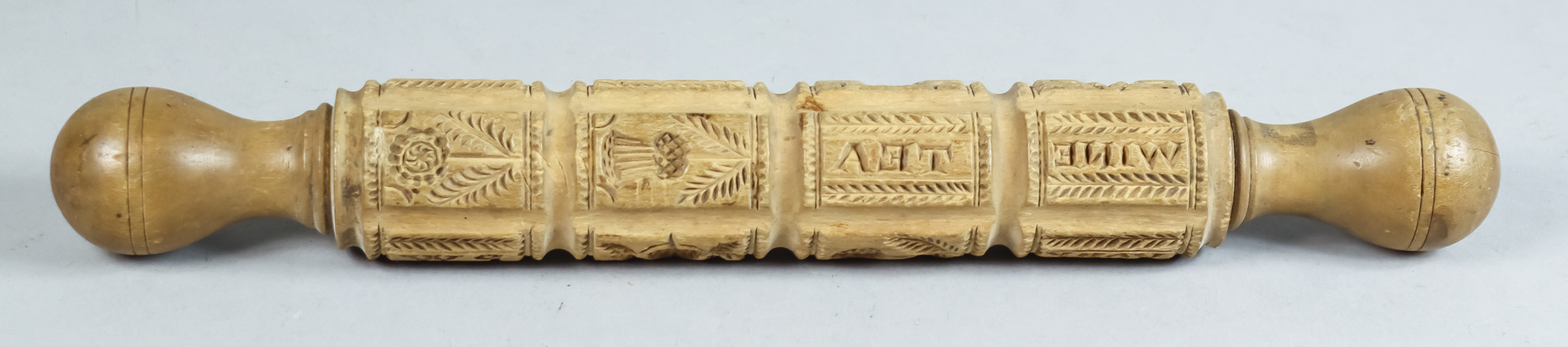 A Carved Wood Roller, Victorian, carved with motifs including - Prince of Wales feathers, crown,