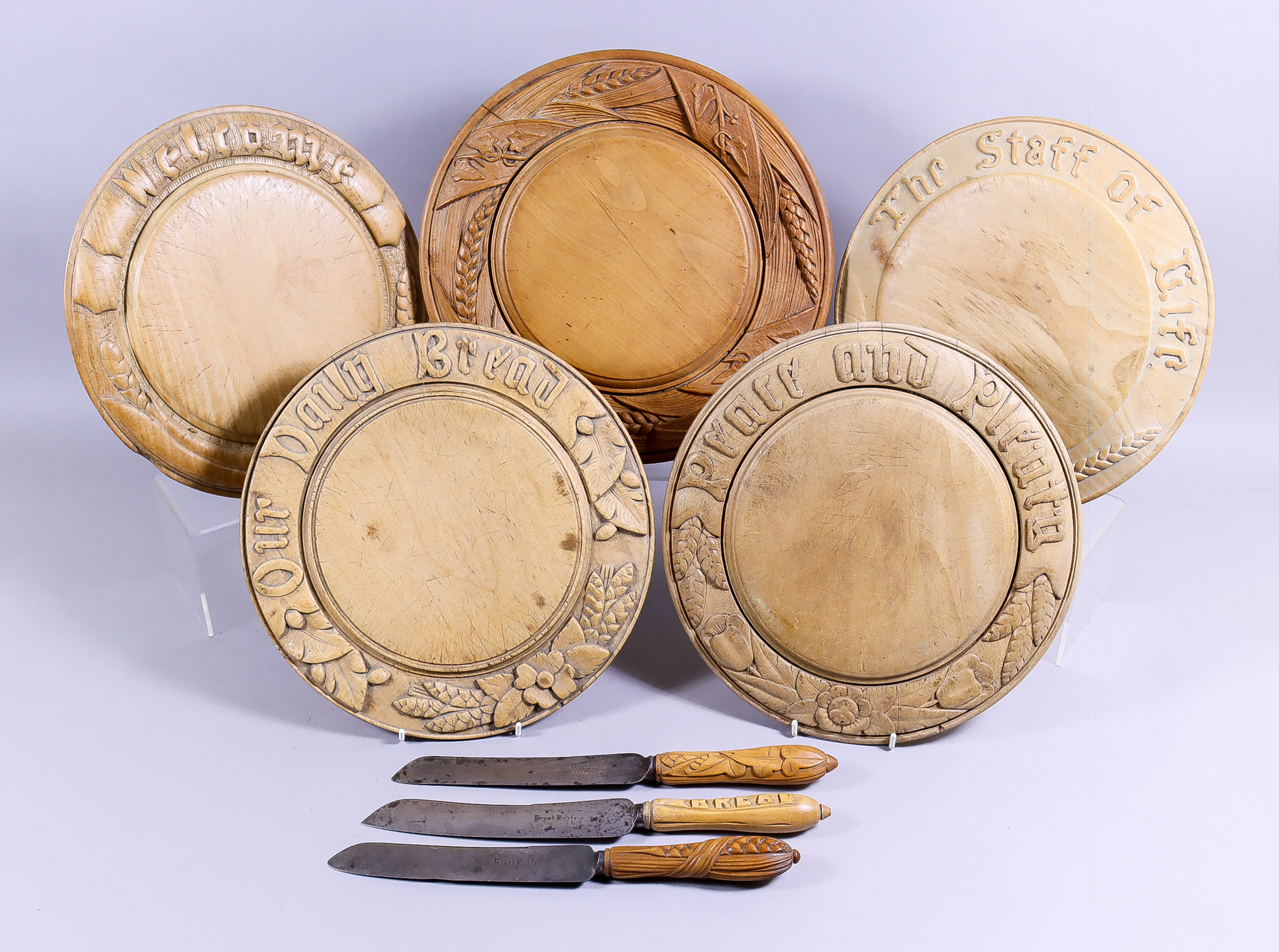 Five Turned and Carved Wood Bread Boards, Late Victorian, including one carved with wheat and ivy,