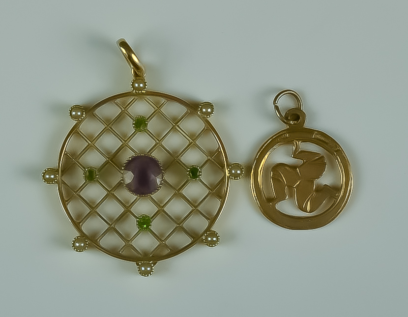 An Amethyst, Peridot and Seed Pearl Pendant, Modern, 9ct gold set with a centre faceted amethyst