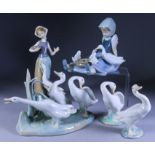 A Collection of Thirteen Lladro Porcelain Figures, including - young girl seated with duck and