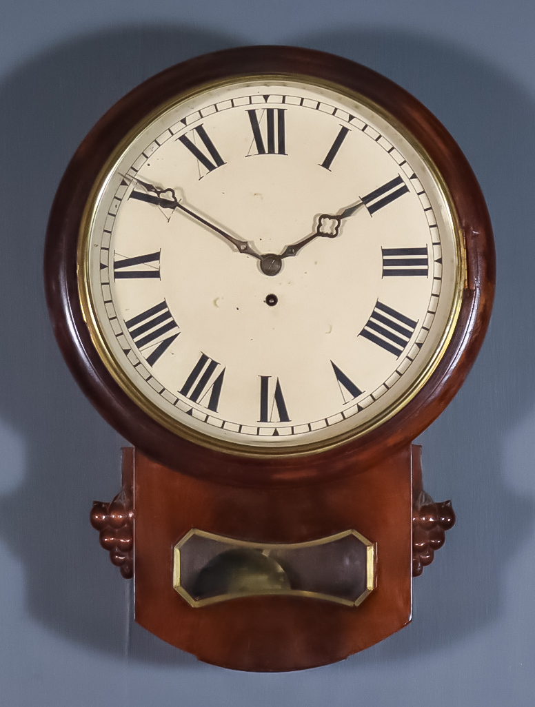 A Victorian Mahogany Drop Case Dial Wall Clock, the 12ins diameter painted metal dial with Roman