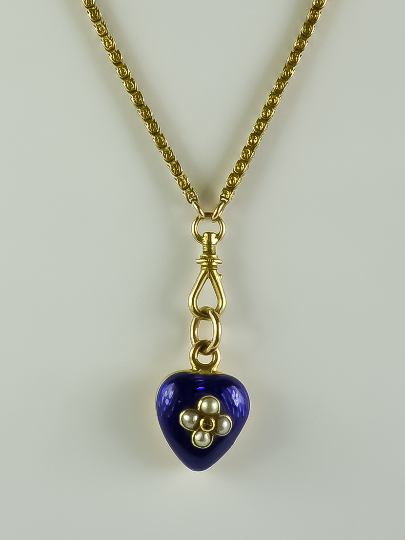 A 9ct Gold Longard Chain, 1400mm overall, suspended with a blue enamelled locket set with seed
