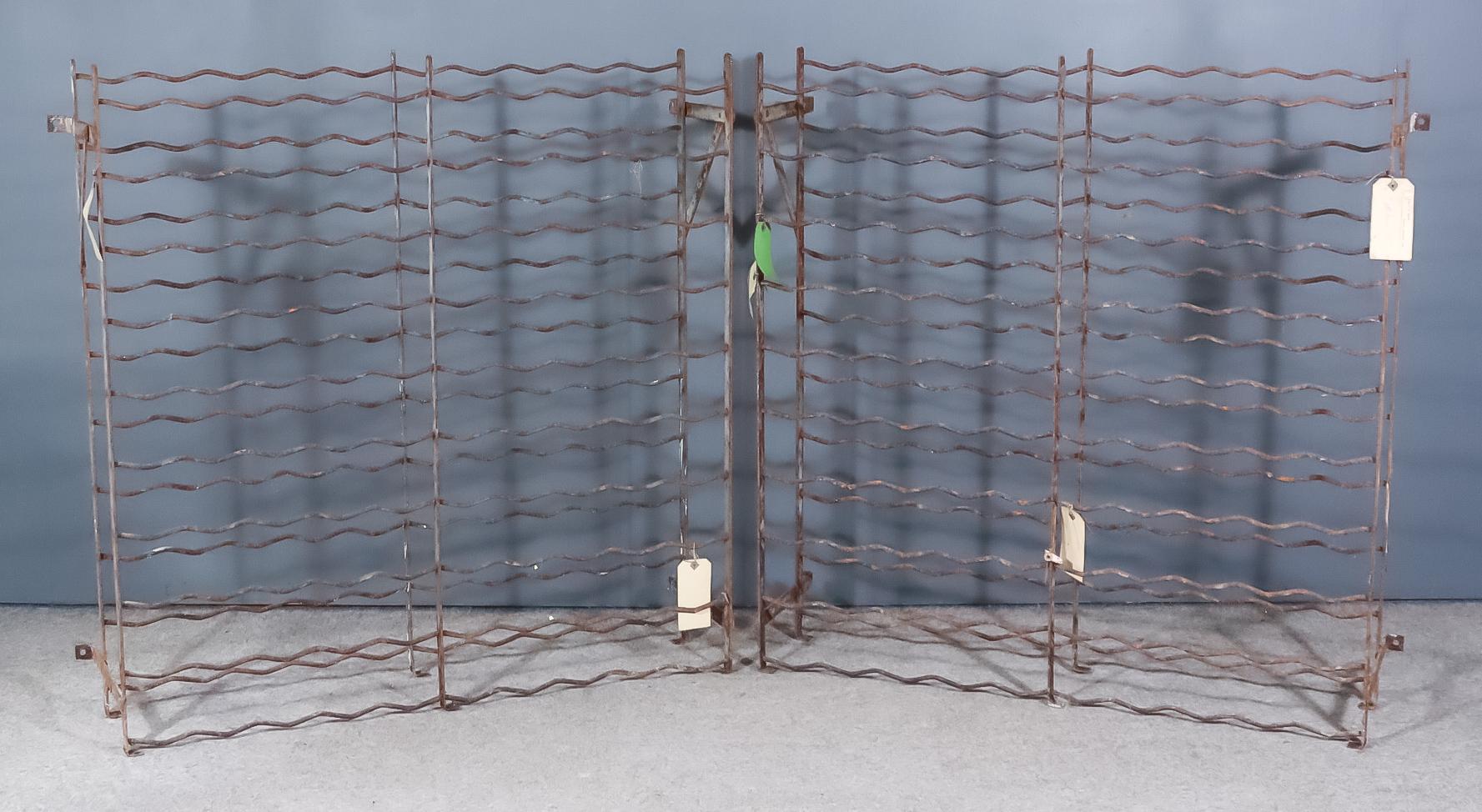Two Oxidised Metal Ten-Tier Wine Racks to hold 100 bottles, each 42.5ins wide x 11.75ins deep x 41.