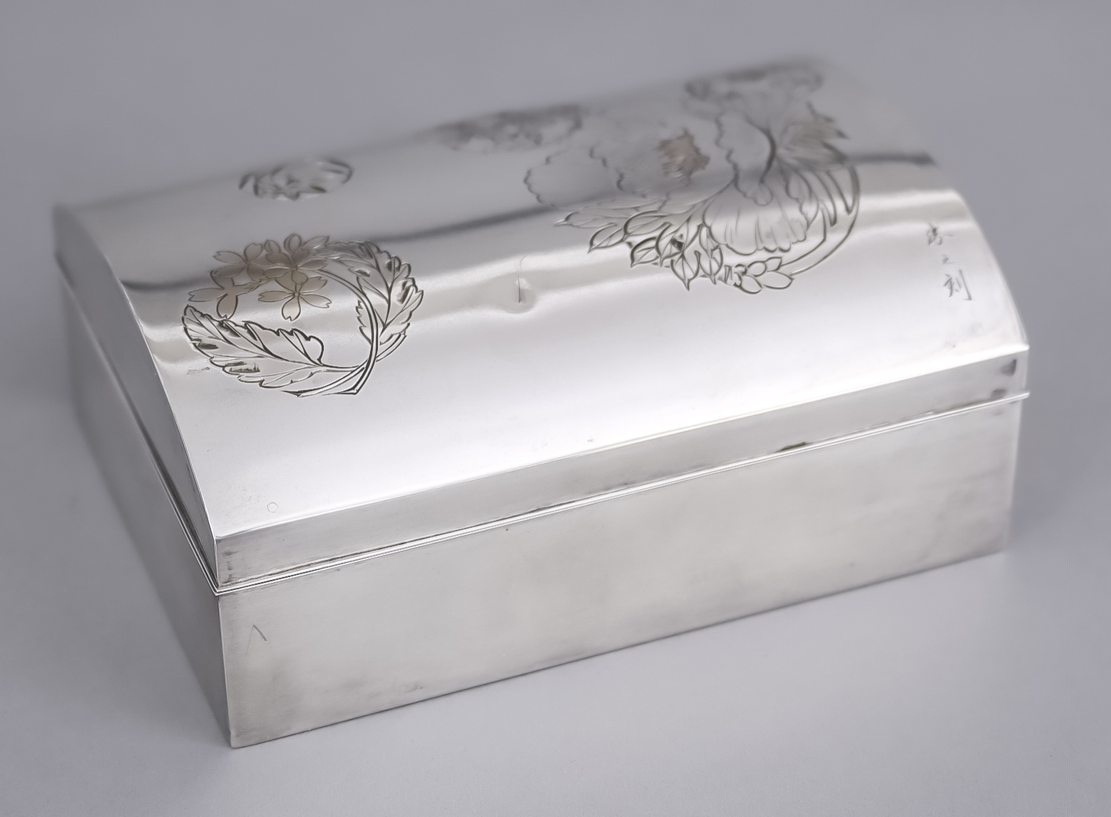 A Japanese Silver and Rosewood Lined Rectangular Box and Cover, Meiji Period, the domed lid engraved