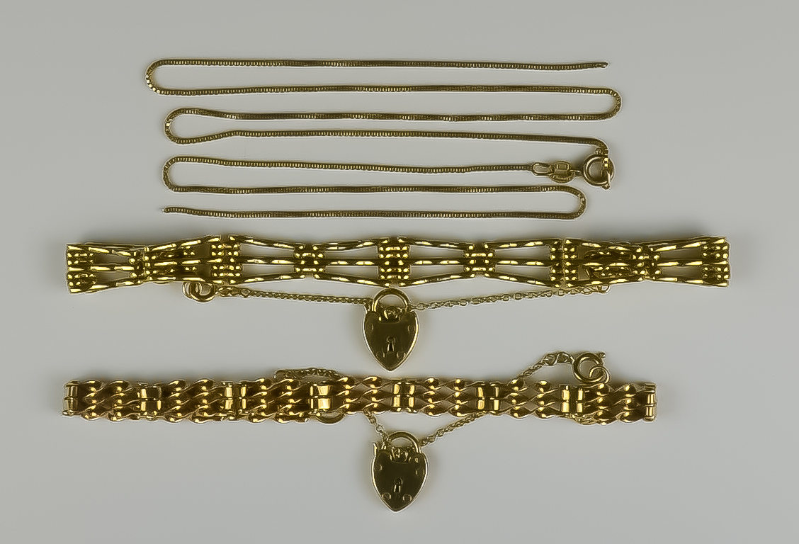 A Mixed Lot of 9ct Gold, Modern, comprising - two three-bar bracelets with padlock clasps, and one