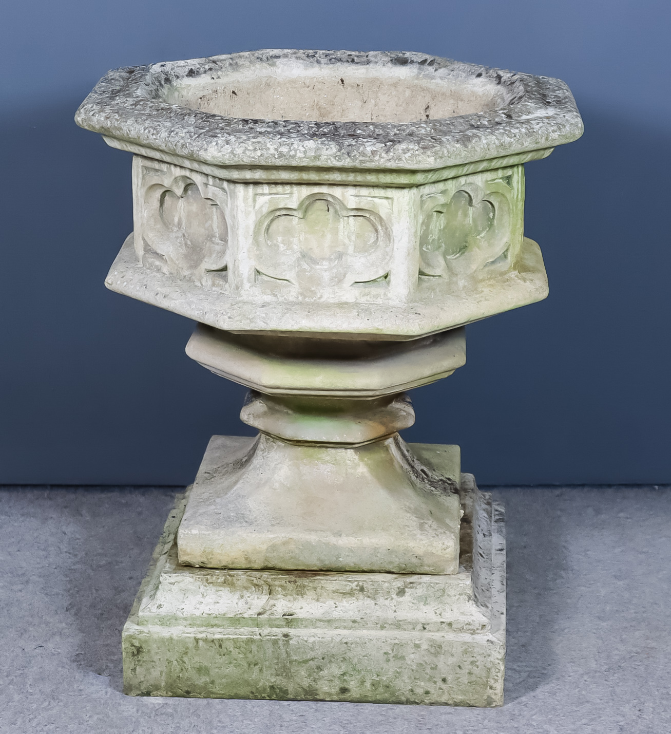 A Stone Composition Octagonal Planter on Stepped Base, 20th Century, the sides cast with