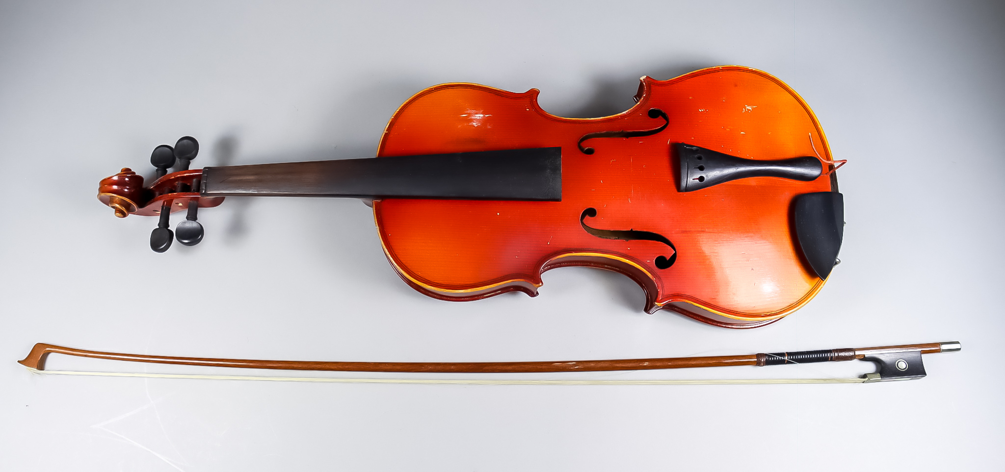 A French Violin, 20th Century, with two piece back, back measurement (excluding button) 14.5ins -