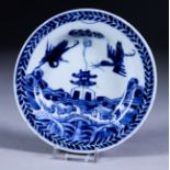 A Chinese Blue and White Porcelain Circular Dish, Yongzheng Period, painted with two cranes above