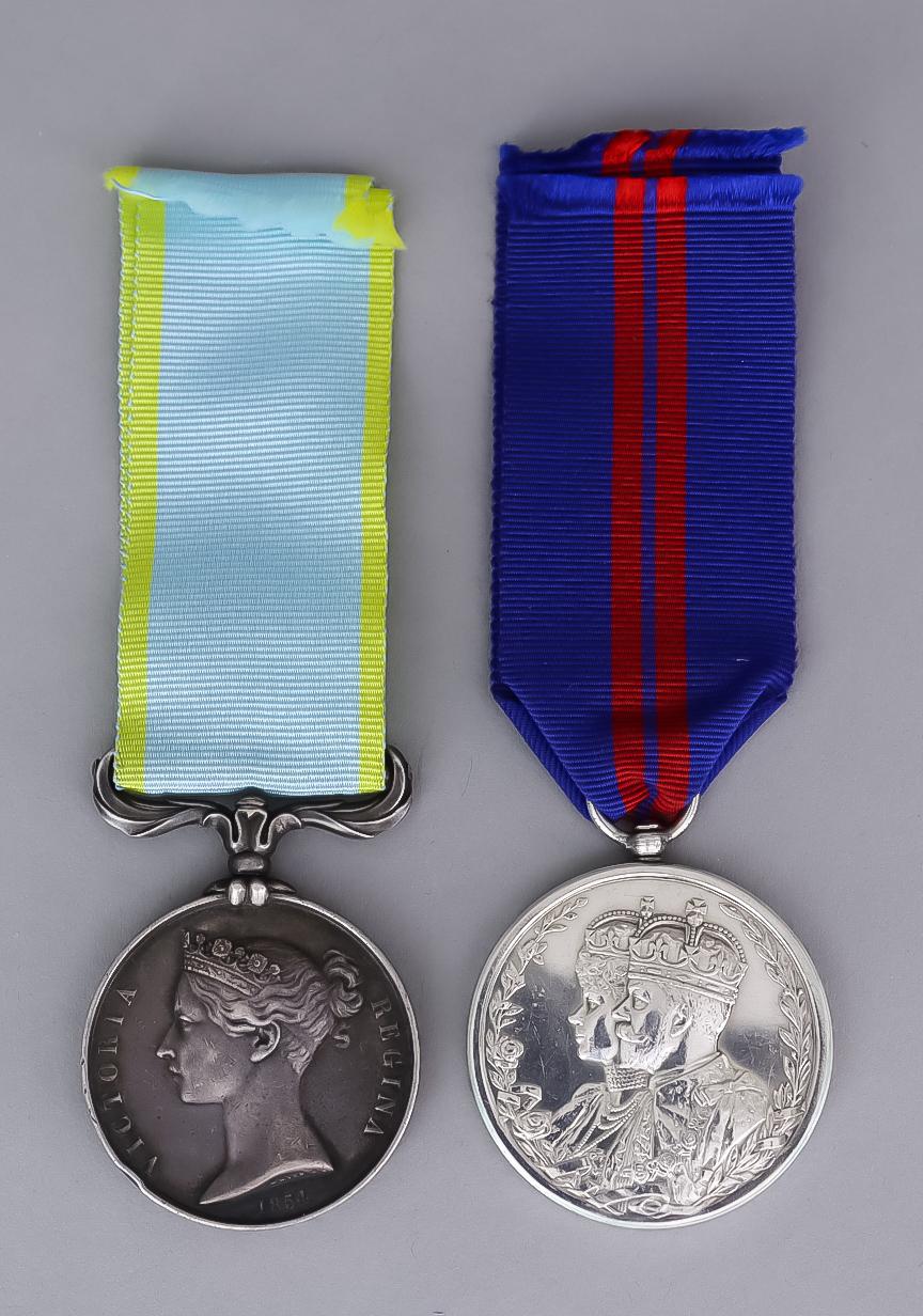 A Victorian Crimea Medal, unnamed, and a 1911 George V Delhi Durbar Medal