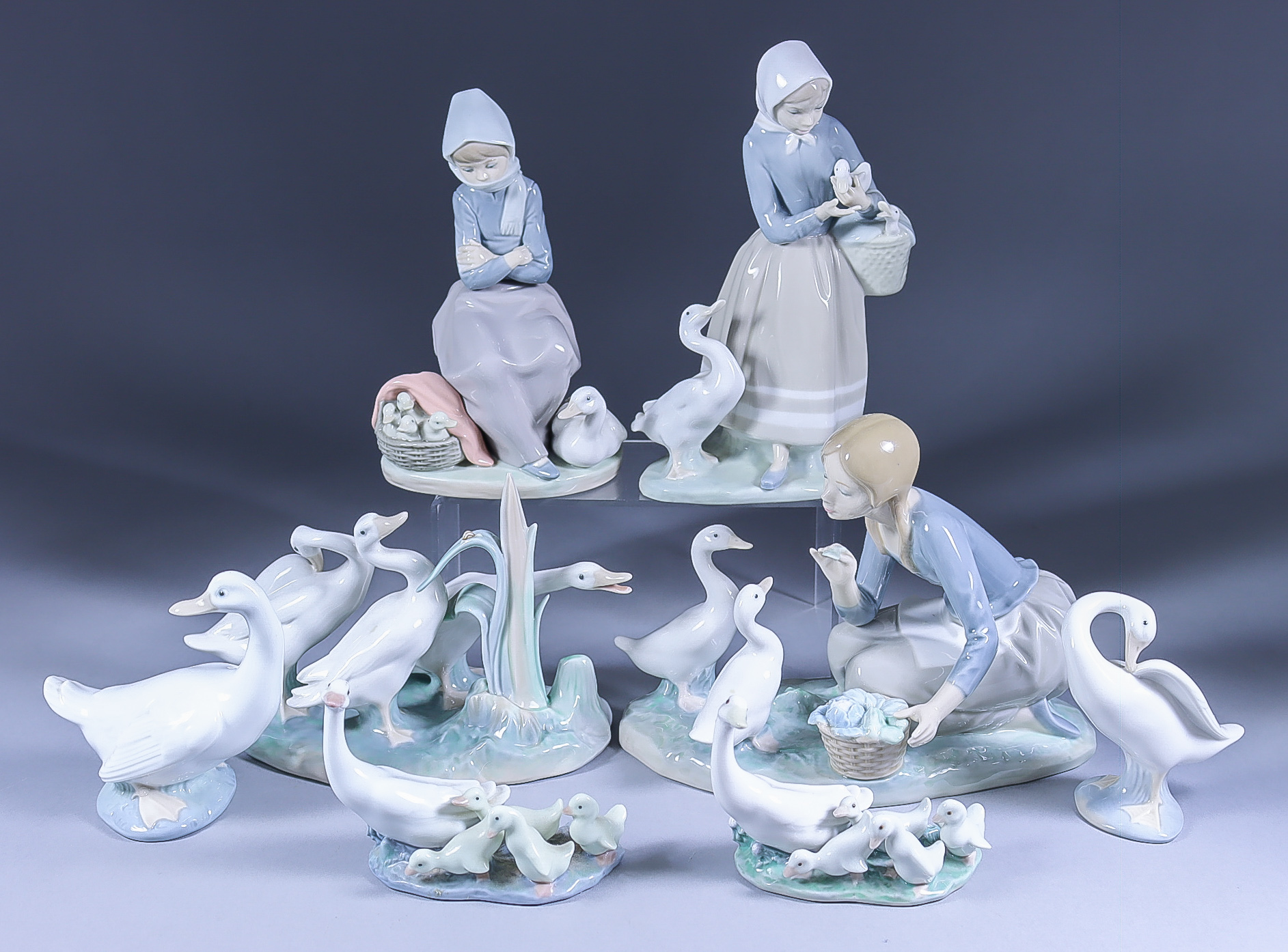 A Collection of Lladro and Nao Porcelain Figures, including - kneeling girl feeding two ducks, 6.