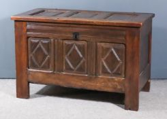 """A Panelled Oak Coffer of """"17th Century"""" Design, with three fielded panels to lid and front, the"""