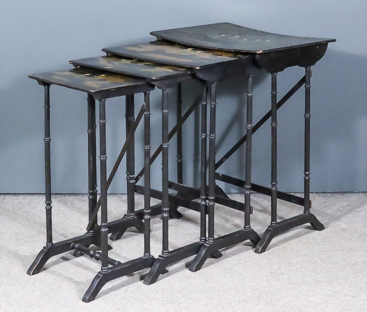A Nest of Four Early 20th Century Black Lacquered Rectangular Occasional Tables, decorated in