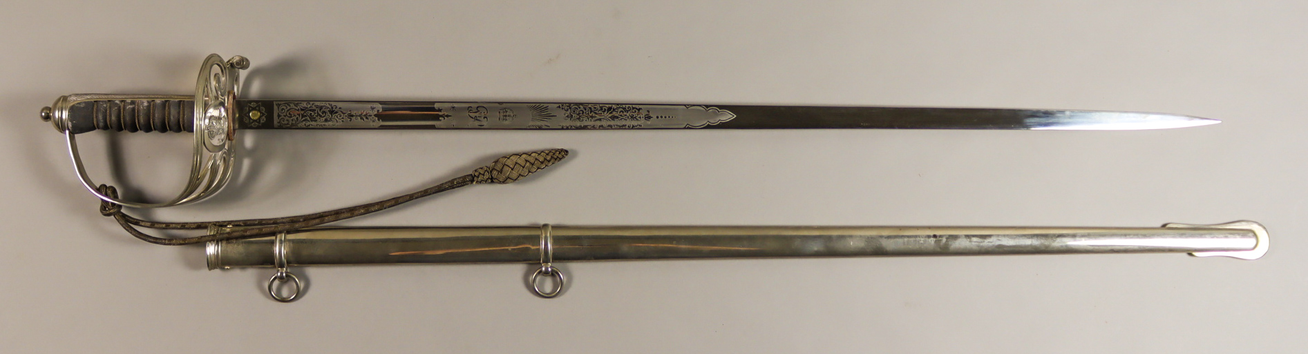 A George VI Police Officer's Dress Sword, the 31.5ins blade etched with Portsmouth City crest,