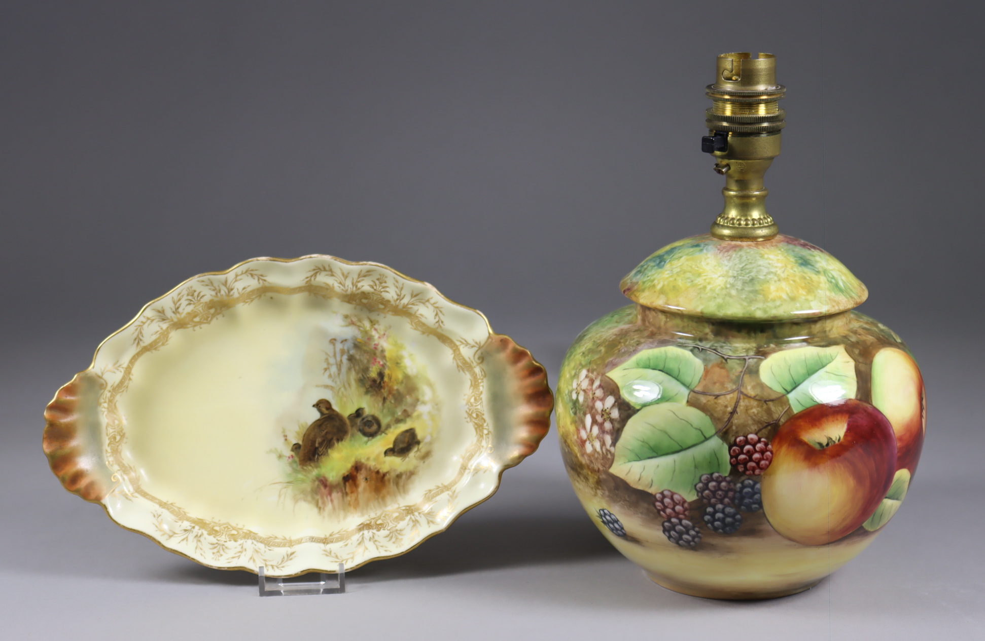 A James Skerrett Bone China Table Lamp painted with Fruit, signed, 8.75ins high, with shade, and a