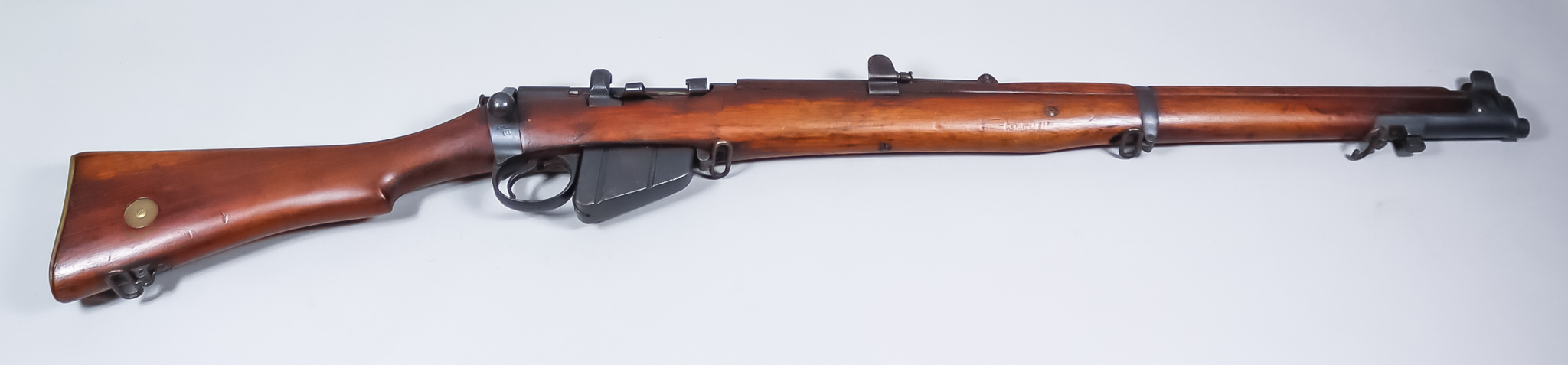 A .303 Calibre Bolt Action Rifle by Lee Enfield,shot magazine MKIII, (1911), Serial No. 4002,