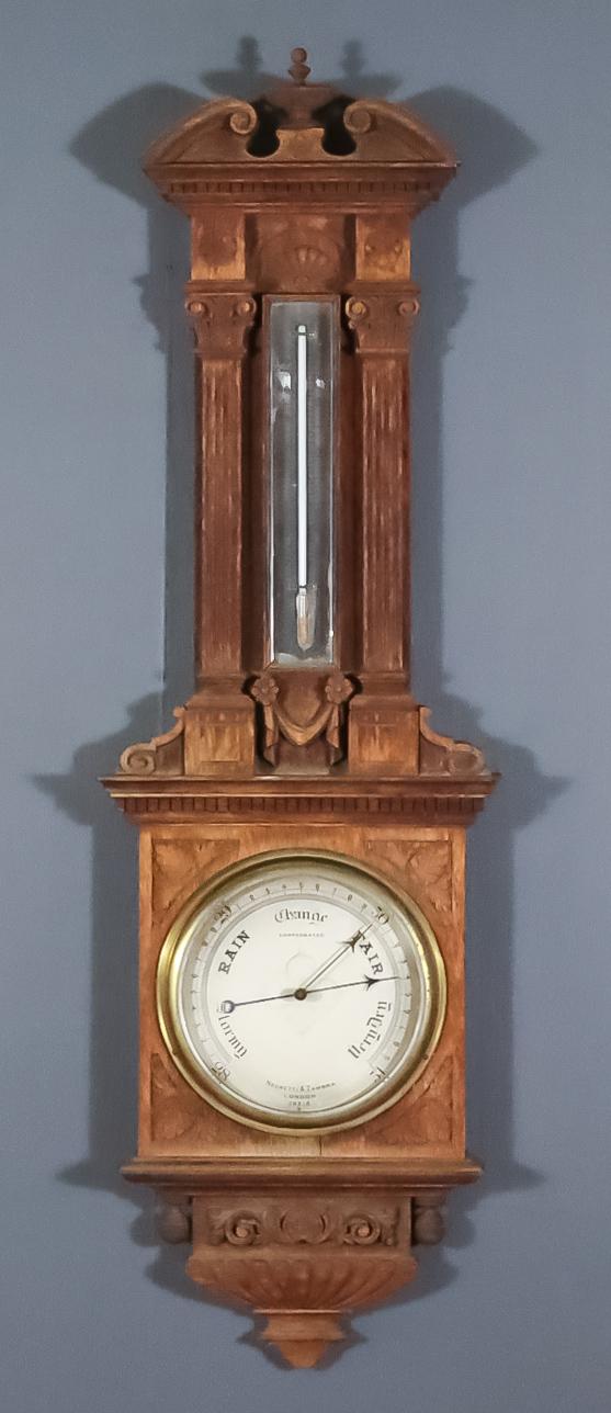 A Late Victorian Oak Aneroid Barometer and Thermometer, by Negretti & Zambra of London, No. 29313,