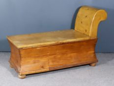 A Continental Pine Scroll End Chaise Longue/Coffer, with incurved sides on bun feet, 48ins long x