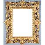 An Italian Florentine Rectangular Wall Mirror, Late 19th/Early 20th Century, the mirror frame boldly