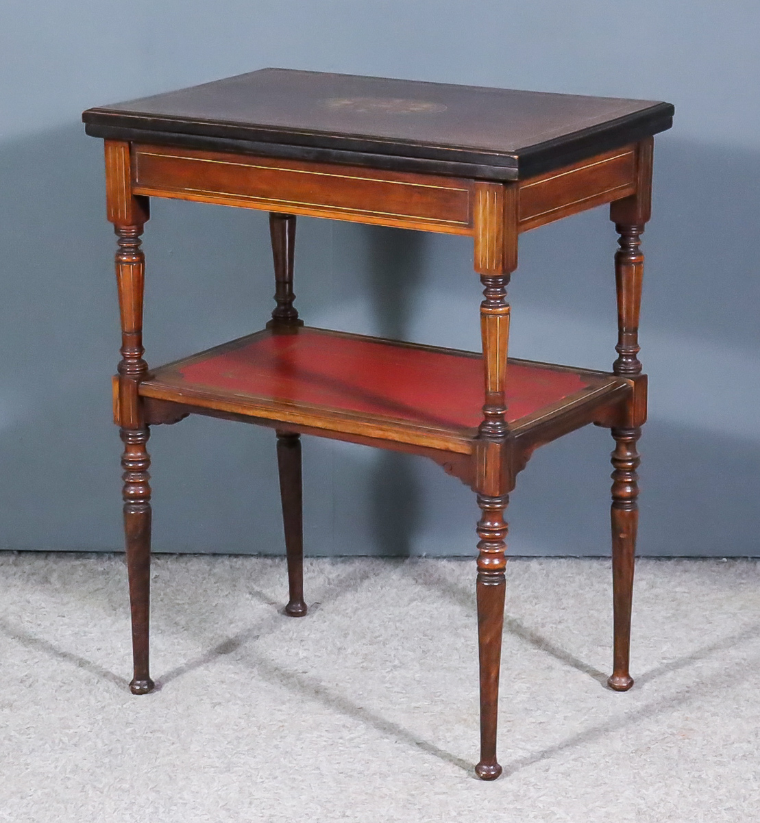 A Late Victorian Inlaid Rosewood Rectangular Card Table, with red leather and gilt folding top, on