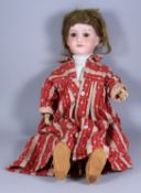An Armand Marseille Bisque Doll, No. 390, Late 19th Century, with brown closing eyes and open