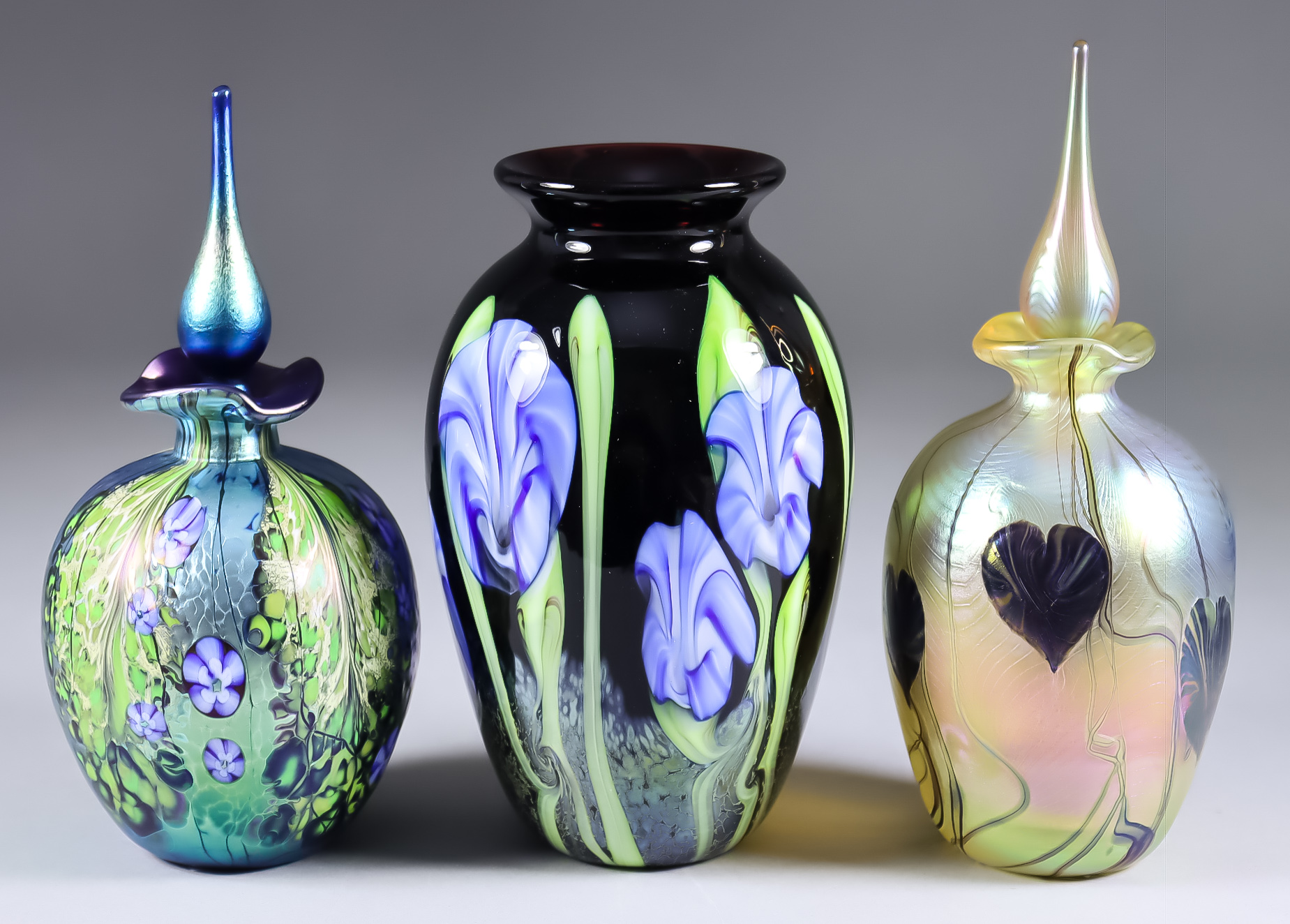 """An Okra Studio Glass Vase, 2002, with """"Morning Glory"""" design, 6ins high, a perfume bottle with """"Gold"""
