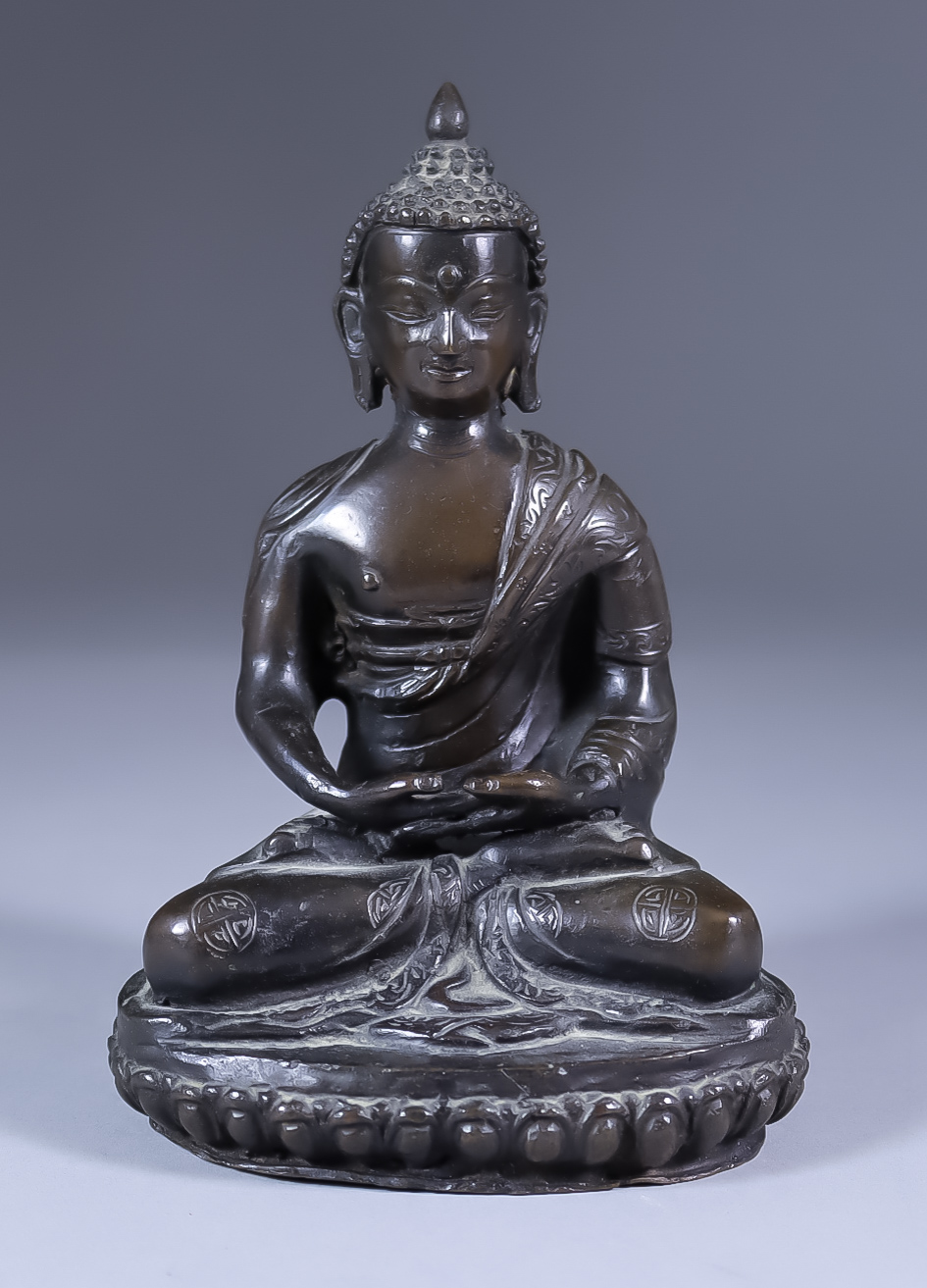A Chinese Brown Patinated Bronze Figure of a Seated Buddha, 5.75ins (14.5cm) high