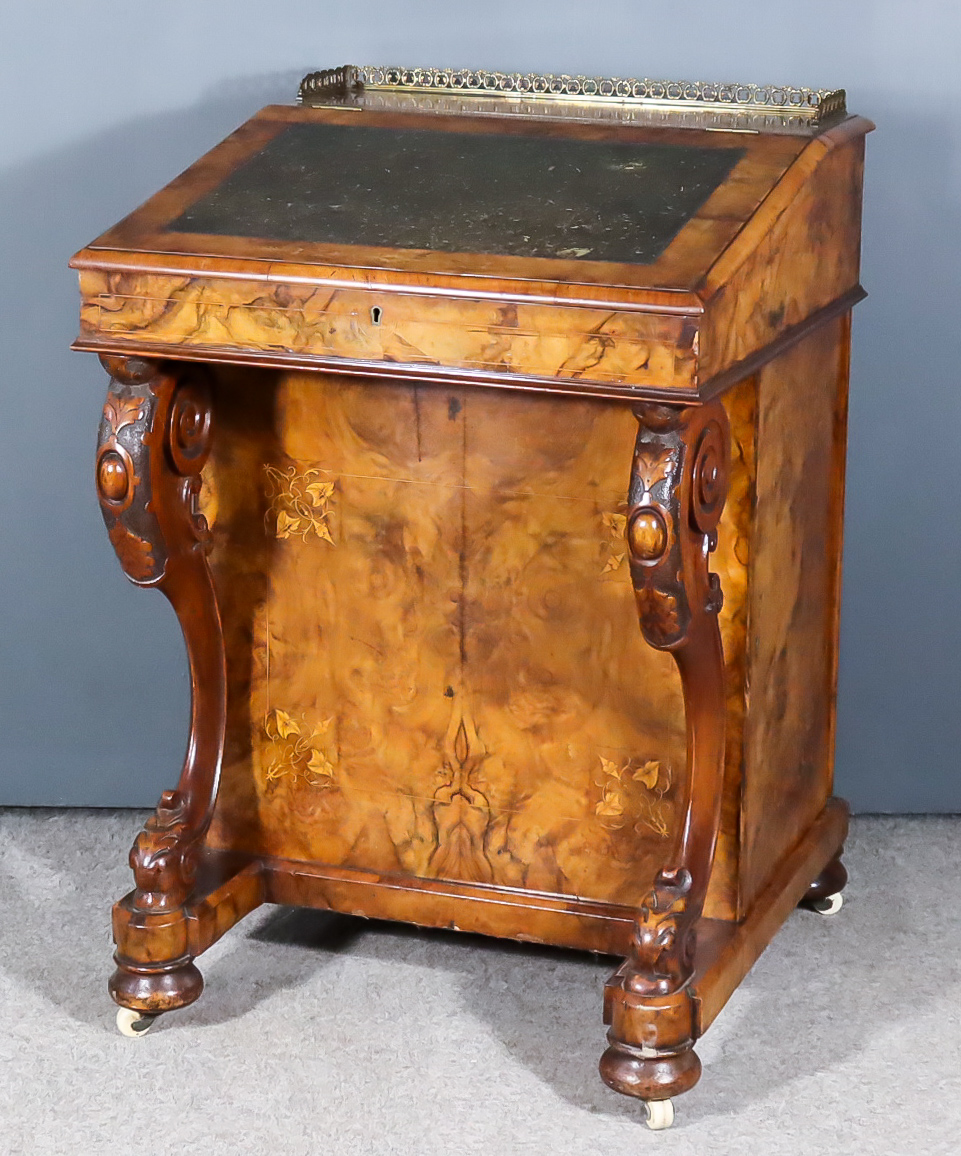 A Victorian Figured Walnut Davenport, inlaid with boxwood arabesques, with gilt brass gallery