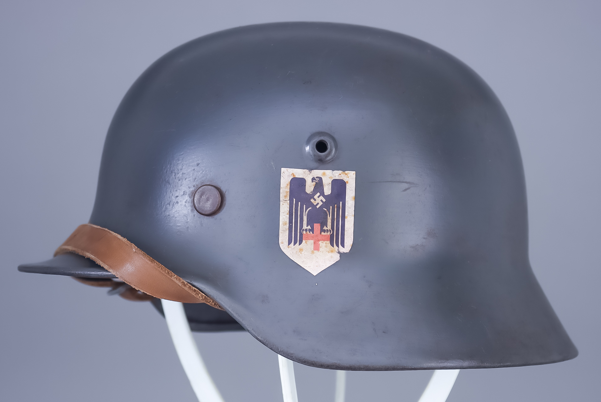 A German World War II Helmet, painted, with single decal