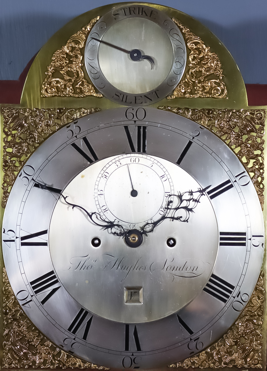 A George III Mahogany Longcase Clock, by Thomas Hughes of London, the 12ins arched brass dial with - Image 2 of 2