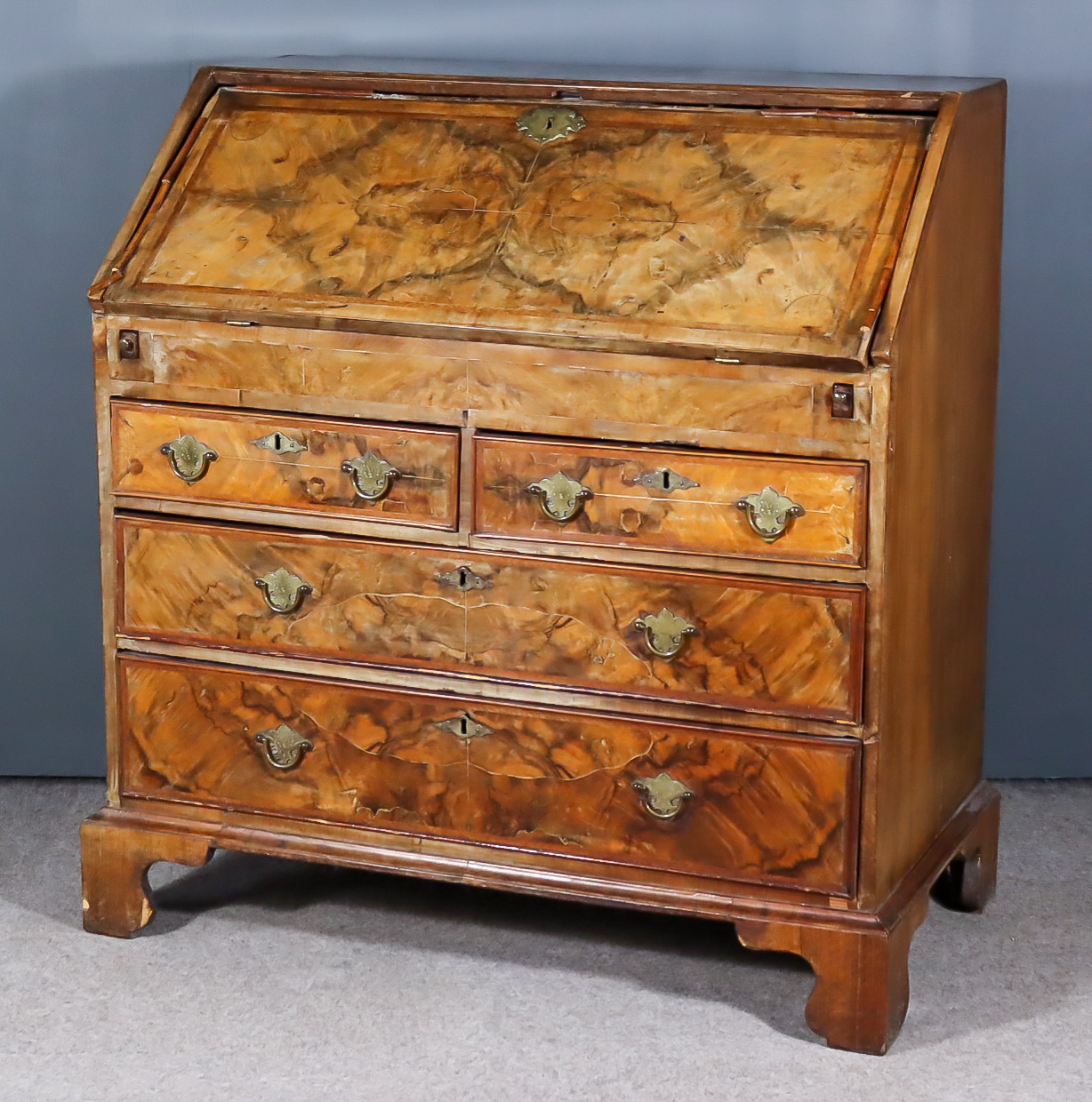 A Mid 18th Century Walnut and Oak Sided Bureau, the top and front inlaid with herringbone