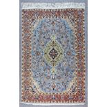 A Qum Rug, Early to Mid 20th Century, woven in pastel shades with a central floral pole medallion on