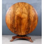 An Early Victorian Figured Mahogany Circular Breakfast Table in the Manx Manner, the butterfly
