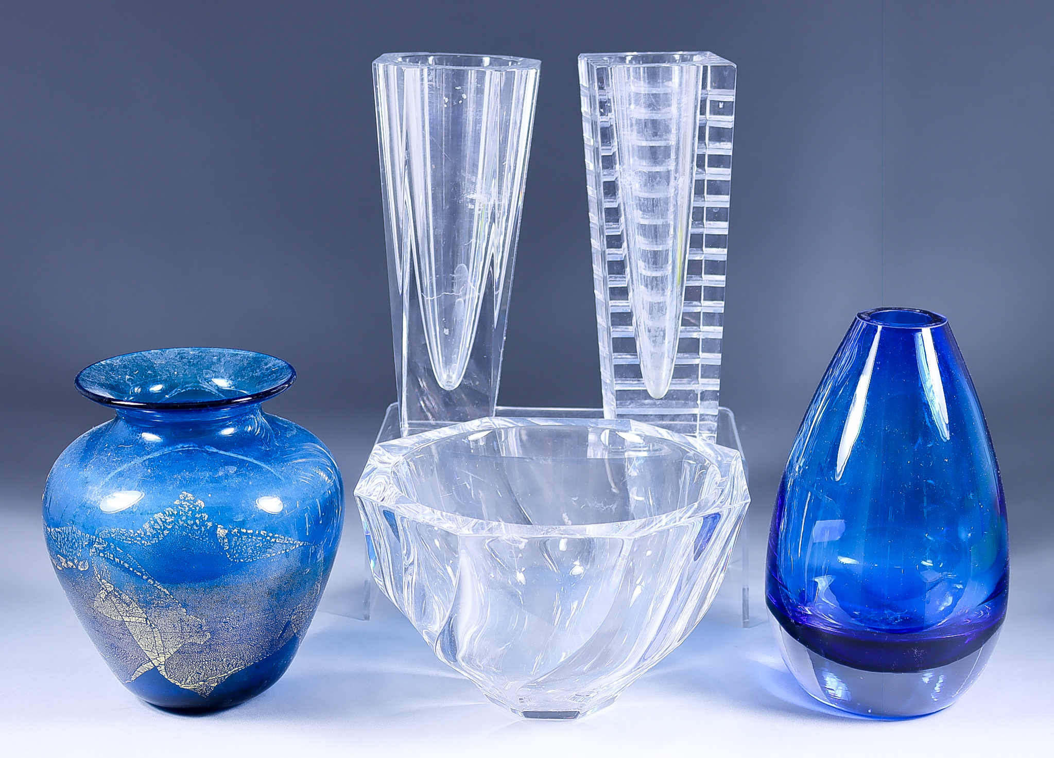 An Orrefors Glass Octagonal Bowl, 7.5ins diameter x 4.75ins high, two Orrefors vases, 8.25ins and