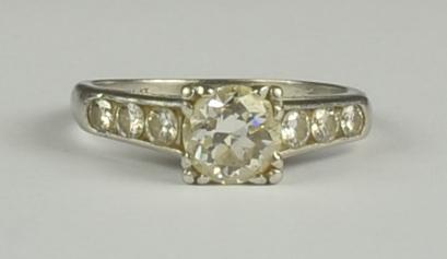 A Diamond Ring, Modern, platinum, set with a centre brilliant cut diamond, approximately .75ct,