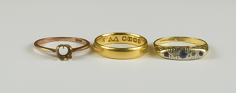 A Mixed Lot of 18ct Gold Rings, comprising - a wedding band, size K+, a five stone gem set ring,