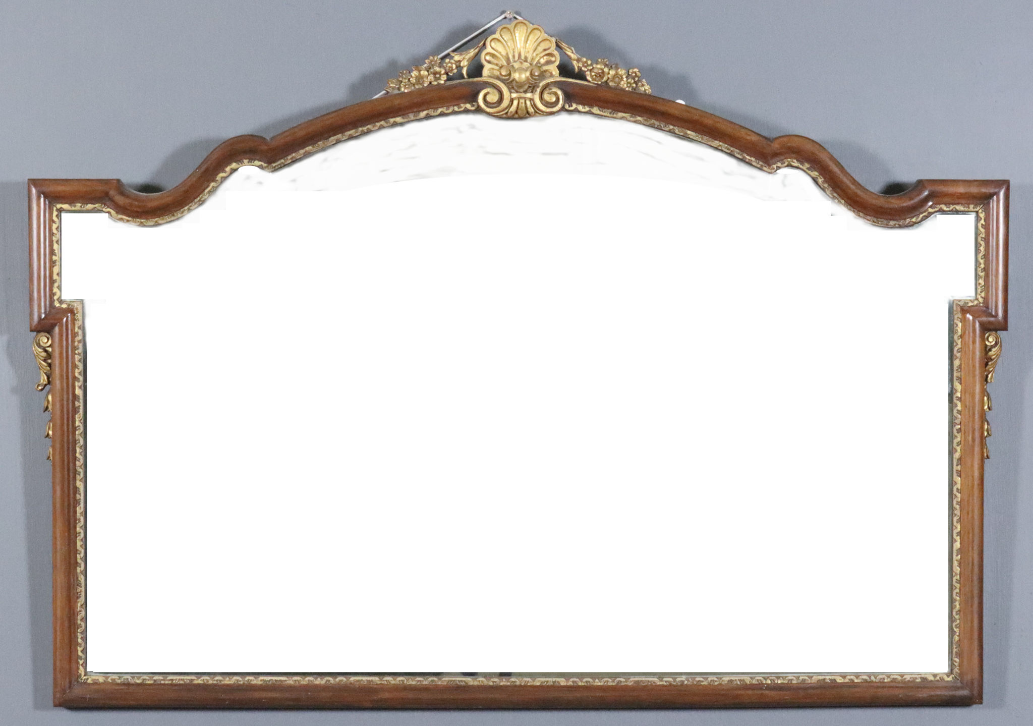 """A Walnut and Gilt Overmantel Mirror of Shaped Outline of """"18th Century"""" Design, 1930's, with bold"""