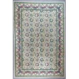 """A Modern Needlework Carpet of """"Aubusson"""" Design, woven in colours of fawn, blue, green and rose,"""