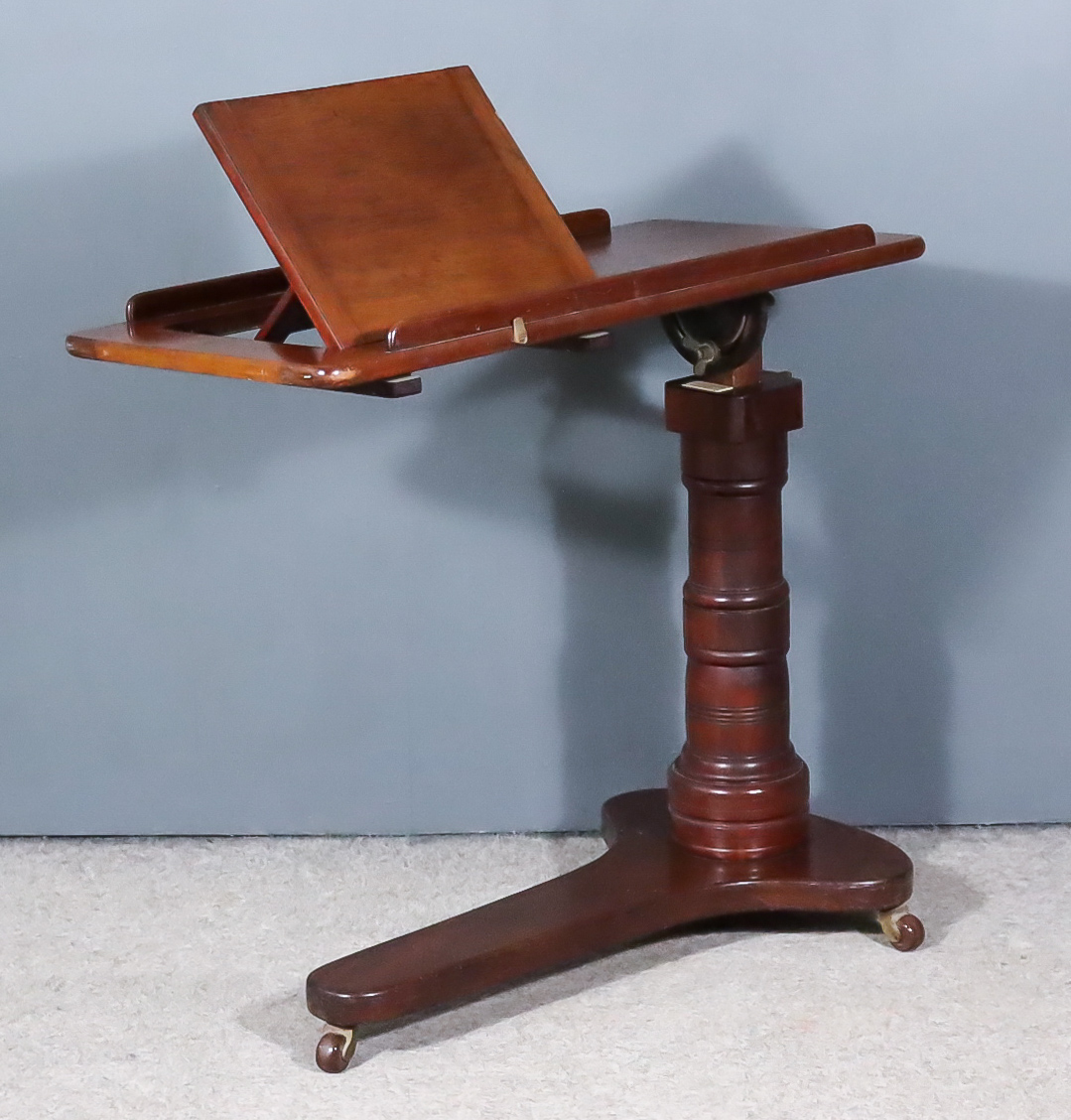 A Late Victorian Mahogany Adjustable Bed Table, by Levenson & Sons, the rectangular tray top with