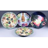 A Moorcroft Pottery Limited Edition 2000 Year Plate, No. 1110 of 2000, 9ins diameter, a Limited