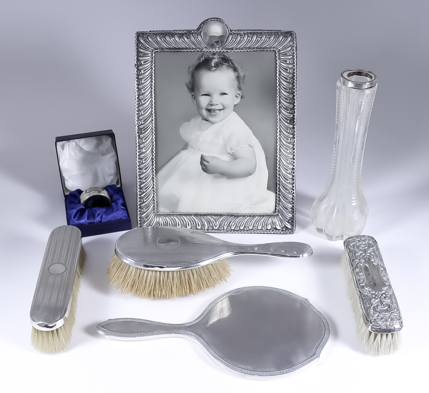 A Late Victorian Silver Rectangular Photograph Frame and Mixed Silverware, the frame by William