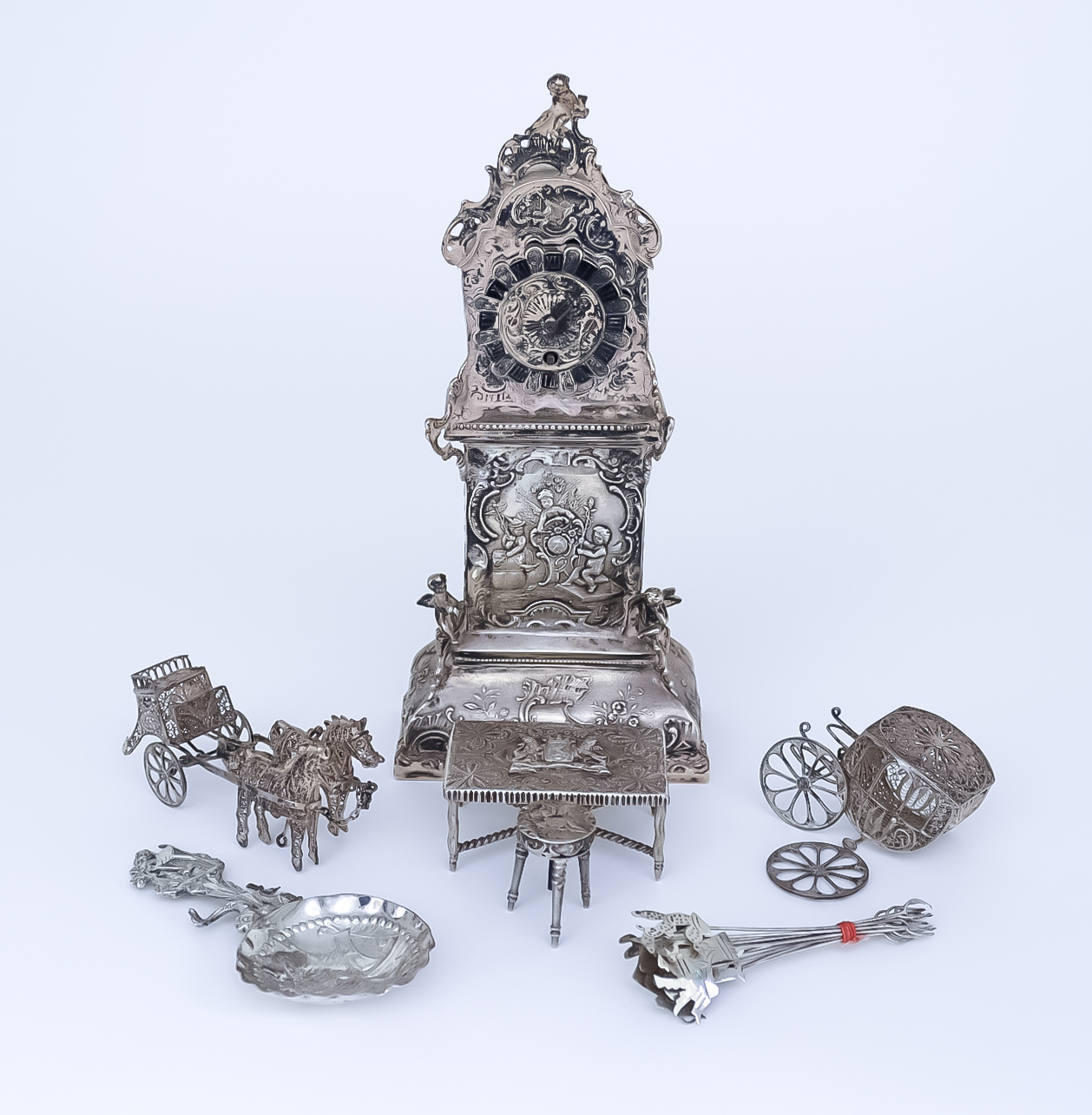 A Late 19th Century Silver Cased Desk Timepiece of Longcase Pattern, and a Selection of other