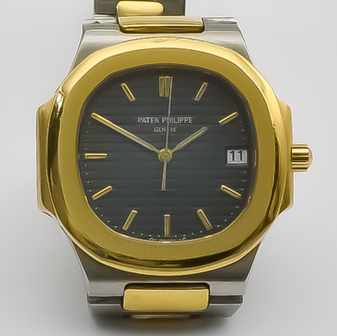 """A Patek Philippe """"Nautilus"""" Quartz Movement Wristwatch, 18ct gold and stainless steel case, 34mm"""