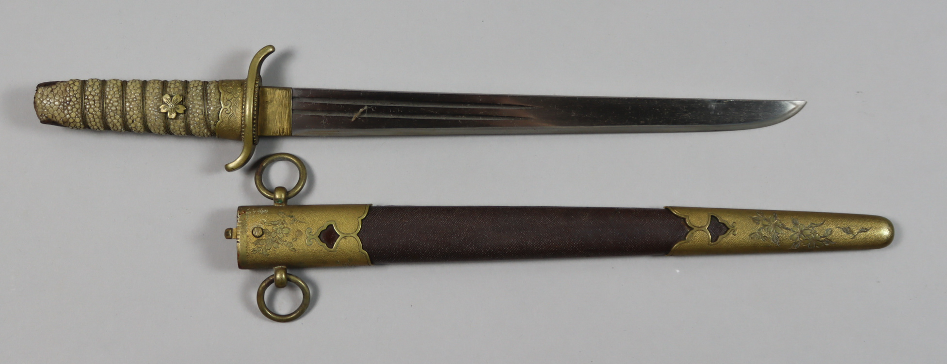 A Japanese Naval Dirk, Atypically wide blade with two fullers
