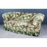 A Victorian Chesterfield, upholstered in rose striped cloth and with loose floral covers, on