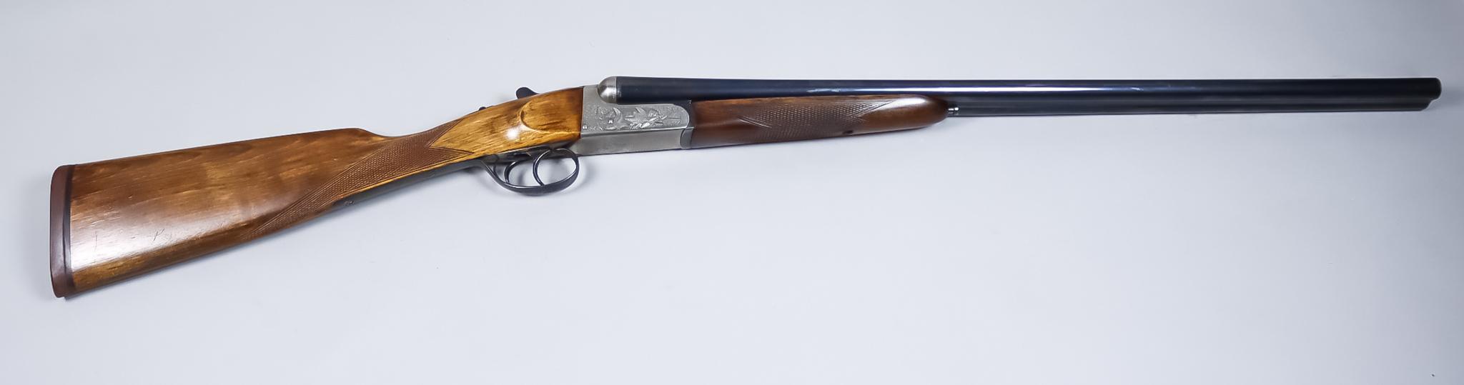 A 12 Bore Side by Side Shotgun, by Eibar of Spain, 28ins blued steel barrels, cased hardened side