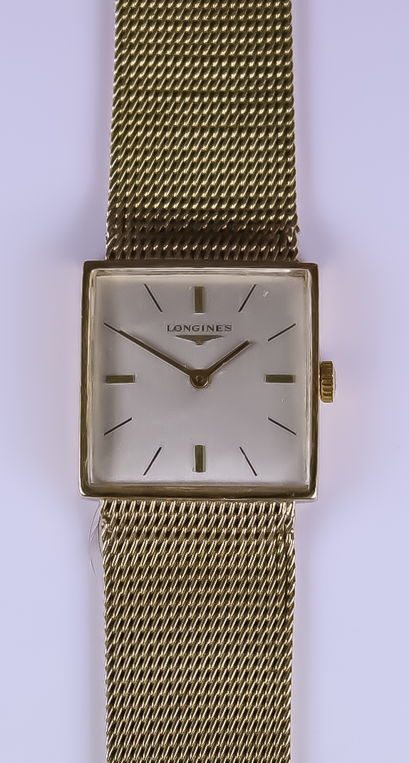 A Longines Manual Wind Wristwatch, 9ct gold case, 25mm x25mm, silver dial with gold baton