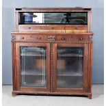 A William IV Rosewood Chiffonier, fitted with an open shelf and three small drawers, the base fitted