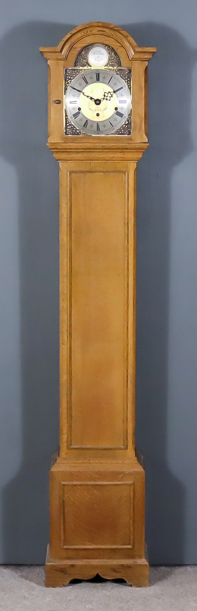 """An Early 20th Century Oak """"Grandmother"""" Clock, by Elliott of London, No. 25249, the 8ins arched"""